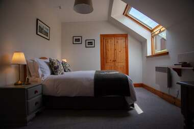 8. A Double En-suite with Hillside Garden view.